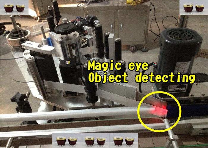 Machine d'application automatique d'étiquettes de bouteille de miel